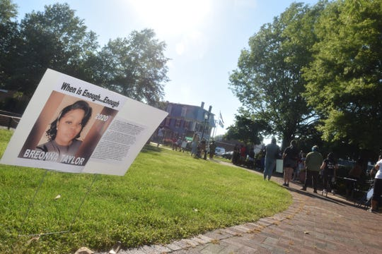 Posters lined The Circle in Georgetown, highlighting lives lost in recent years to acts of racism and police brutality.