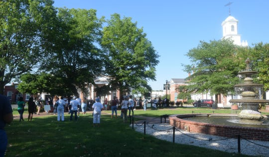 Roughly 75 people gathered on The Circle in Georgetown Tuesday night to pray, sing and speak out against racial injustice and for unity on the day of George Floyd's funeral.