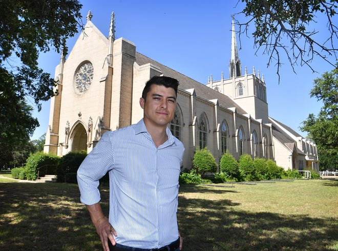 Michael Olaya, CEO of Dexter, stands in front of the former Fain Presbyterian Church on Speedway. The building  will become the school's new location.