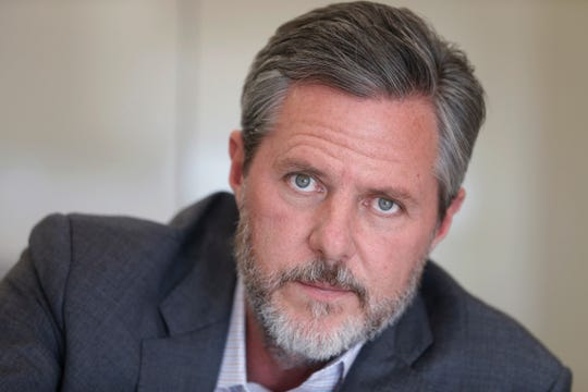 In this Nov. 16, 2016 file photo, Liberty University president Jerry Falwell Jr., poses during an interview in his offices at the school in Lynchburg, Va. Falwell Jr. apologized Monday, June 8, 2020 for a tweet that included a racist photo that appeared on Gov. Ralph Northam's medical school yearbook page decades ago, saying his effort to make a political point had been offensive.