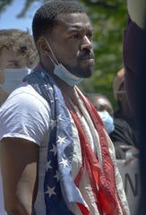 Shan Jones, 33, listens to speakers in Perry Square on June 6, 2020, in Erie, Pa. More than 2,000 people gathered to protest the killing of George Floyd on Memorial Day in Minneapolis.