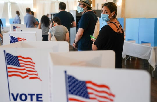 People wait in line to vote in Georgias Primary Election on June 9, 2020 in Atlanta. Voters in Georgia, West Virginia, South Carolina, North Dakota, and Nevada are holding primaries amid the coronavirus pandemic.