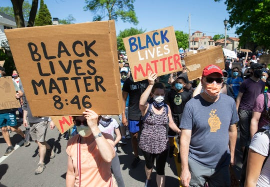 Protesters walk through Shorewood and Whitefish Bay in Milwaukee County, Wisc. to raise awareness of George Floyd and racial justice issues on Saturday, June 6, 2020.