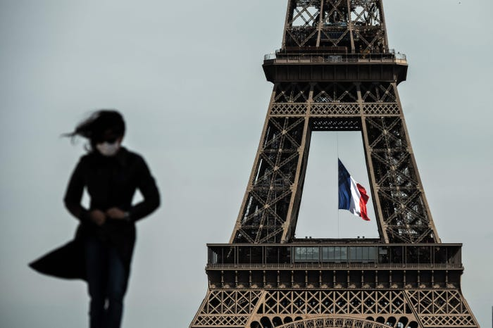 Eiffel Tower reopens in Paris with new restrictions after 104-day coronavirus lockdown