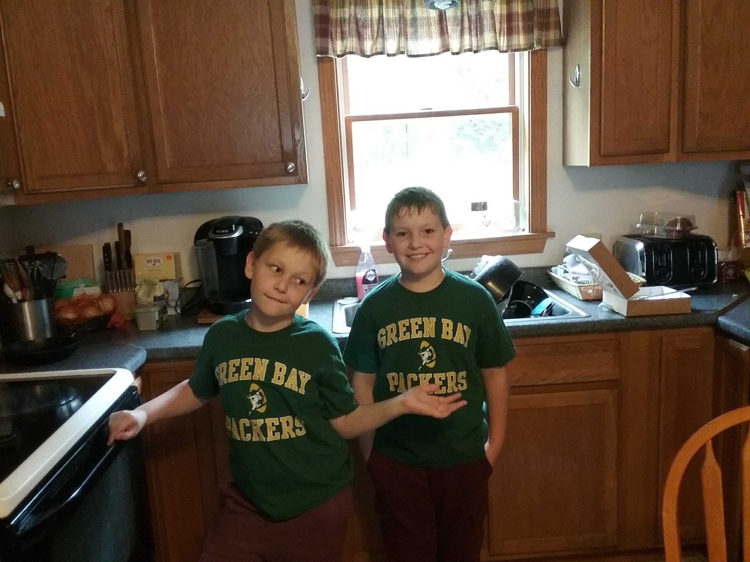 Reader Rick Freeman was thrilled when his grandsons (Owen, left, and Max, right) wanted a Packers shirt - just like the one Rick