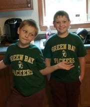 Reader Rick Freeman was thrilled when his grandsons (Owen, left, and Max, right) wanted a Packers shirt -- just like the one Rick's dad gifted him when he was younger.