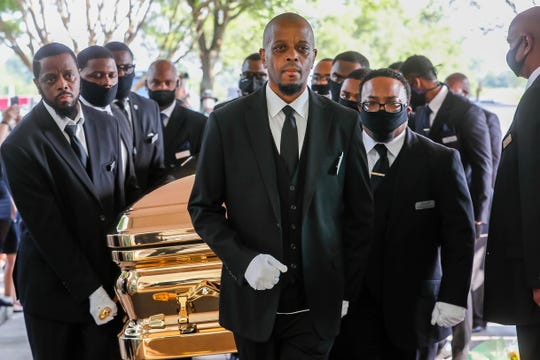 Pallbearers bring the casket of George Floyd into the church for his funeral on June 9, 2020, at The Fountain of Praise church in Houston. Floyd died after being restrained by Minneapolis Police officers on May 25.