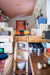 Space is used as efficiently as possible in a currently unoccupied tiny home on the property that will one day be DIY Tiny in East Asheville. Tiny homes typically utilize as much vertical space as they can to maximize the potential of their small square footage.