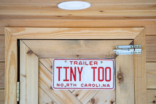 A vanity plate adorns the back of a currently unoccupied tiny home on the property that will one day be DIY Tiny in East Asheville.