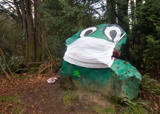 FILE PHOTO - A mask on Frog Rock on Bainbridge Island.