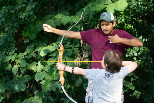 A camper learns to shoot a bow and arrow at Camp Abnaki. The nearly 120 year old camp decided to close for summer 2020 because of challenges meeting safety guidelines during the pandemic.