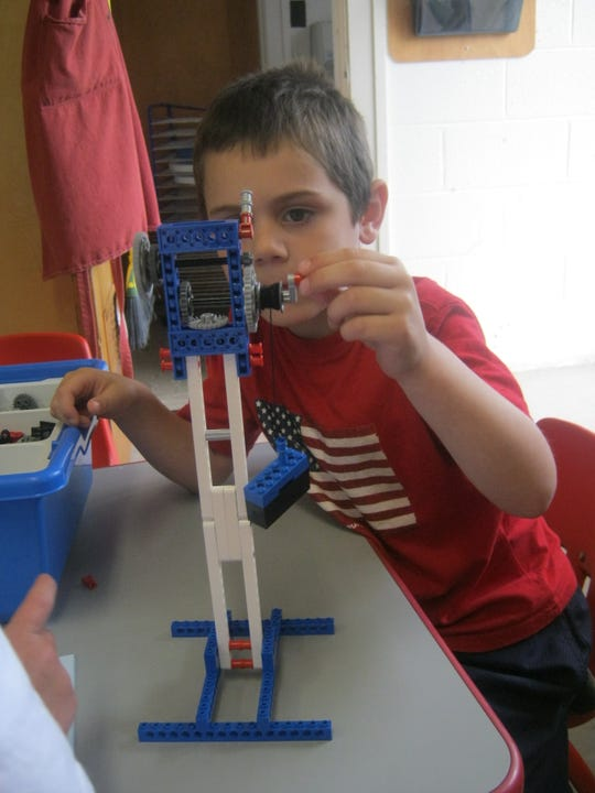 A camper works on engineering contraptions with LEGOs. The LetGo Your Mind summer camps will be offering STEM-based camps virtually summer 2020. Participants will be mailed kits and watch videos to complete projects.