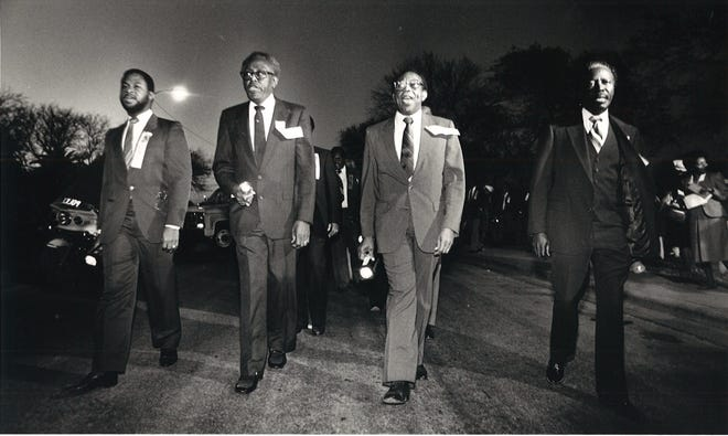 Reverends Jimmy Miller (left to right), Elliott Grant, Harold Branch and A.O. Gary lead the lighted procession along Winnebago Street in Corpus Christi in celebration of Martin Luther King Jr.'s birthday on Jan. 15, 1986. The first national observance of the federal holiday was Jan. 20, 1986.