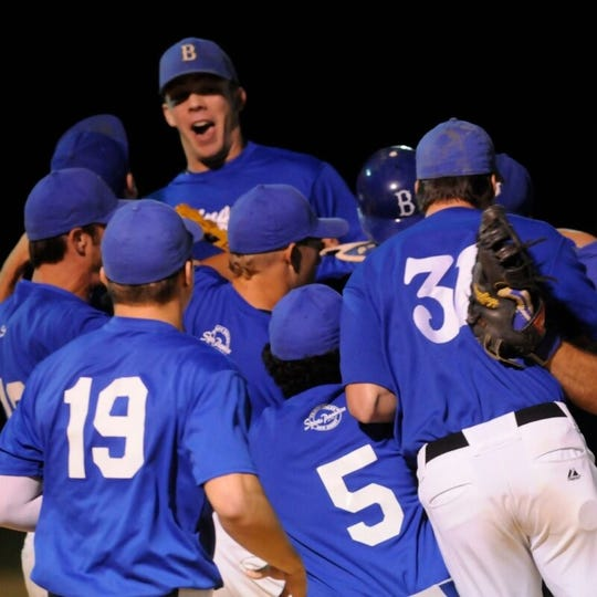 Burlington players celebrate after the final out in Game 4 of the 2013 RVL championship series.
