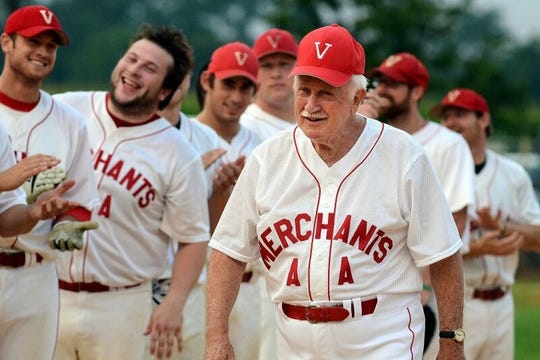 Harry W. Thompson, manager of the Vincentown Merchants AA is applauded by his players as he is recognized for his 1,000th Rancocas Valley League win on July 30, 2012.
