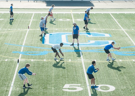 The Chillicothe High School football team practices extreme social distancing during Tuesday morning's football practice at Herrnstein Field on June 9, 2020.