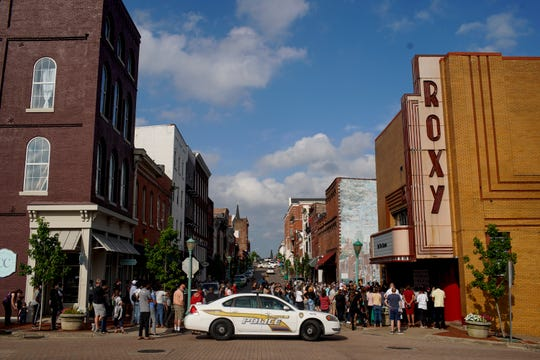 A Clarksville Police car blocks off the intersection of Franklin and 1st to allow the gathering to turnoff the lights at the Roxy Regional Theater in Clarksville, Tenn., on Tuesday, June 9, 2020.