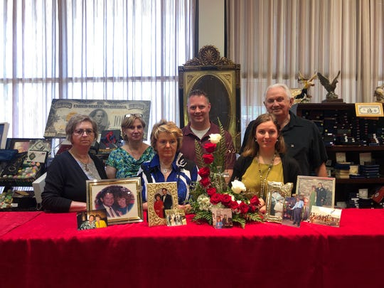 Family and staff members of Golden Eagle Jewelry on Riverside Drive stands in front of memorabilia in honor of Johnnie Gilreath. From left to right, Margot Craven, Ellen DiSilvio, Elke Gilreath, Josh Mcleskey, Lydia Nichols, Richard Gilreath. June 10, 2020.
