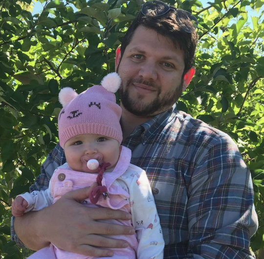Brandon Kornbluh, the School Counselor for Health & Wellness at Somerset County Vocational & Technical High School, poses with his daughter, Isabella.