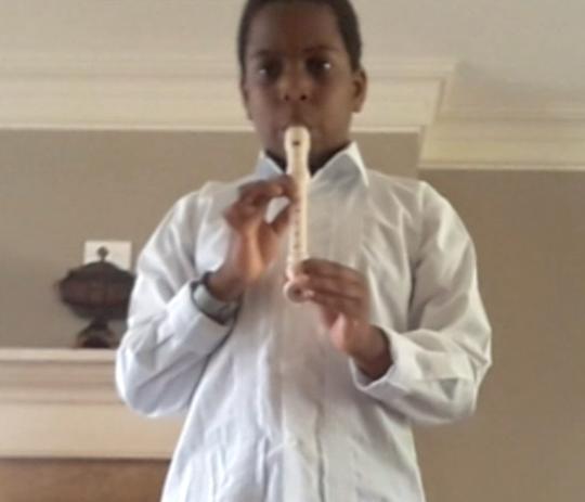 Brent Xavier of Westfield plays recorder at the third grade virtual recital.