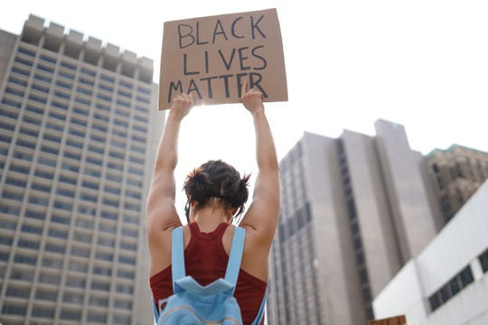 Protesters march along Michigan Avenue in downtown Detroit during the thirteenth day of protests against police brutality on Wednesday, June 10, 2020.