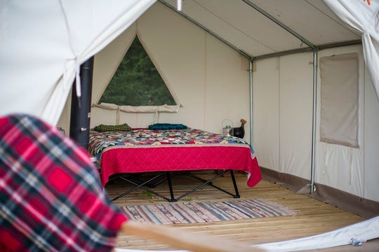 The inside of a safari-style tent that will be available for rental at two Michigan state parks.