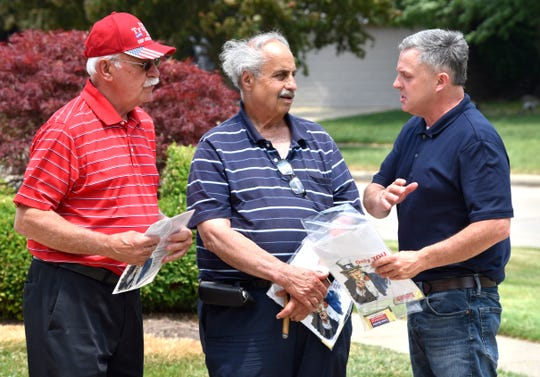 Mike Olejarczyk, left, and Tony Michael, center, talk with Macomb Township Treasurer candidate Leon Drolet, right, all of Macomb Twp., as Drolet, a current Macomb County Commissioner, hands out campaign literature, Wednesday afternoon.   Current Macomb County Commissioner Leon Drolet, of Macomb Twp., hands out campaign literature to neighbors on Tilch Rd. south of 22 Mile Rd, in Macomb Twp., Wednesday afternoon, June 10, 2020. Drolet is a candidate for Macomb Township treasurer, on the August ballot.