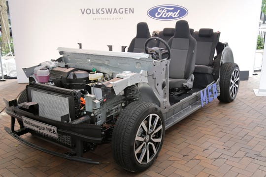 An alliance between Ford and Volkswagen will produce a mediumpickup truck built by Ford and sold by VW as the Amarok; two commercial vans, one built by VW and the other by Ford; and an electric vehicle for Ford of Europe, built on VW's EV architecture, shown here.