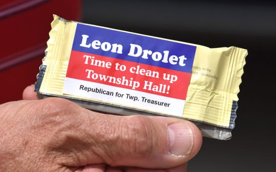 Mike Olejarczyk, of Macomb Twp., shows off a bar of soap in the campaign literature given to him by Macomb Township Treasurer candidate Leon Drolet.  Current Macomb County Commissioner Leon Drolet, of Macomb Twp., hands out campaign literature to neighbors on Tilch Rd. south of 22 Mile Rd, in Macomb Twp., Wednesday afternoon, June 10, 2020. Drolet is a candidate for Macomb Township treasurer, on the August ballot.