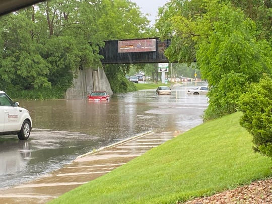 Flooding blocked part of South Main Street, just north of its intersection with Pioneer Road, on Wednesday, June 10, 2020, in Fond du Lac, Wisconsin.