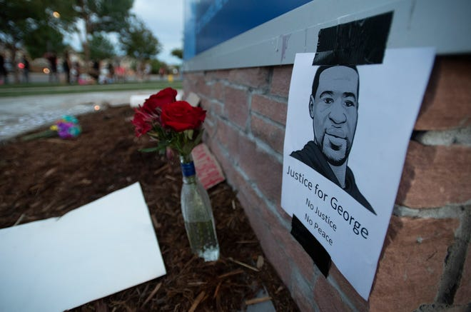 A memorial is located in front of the Fort Collins Police Services headquarters during a protest in response to the police killing of George Floyd, an unarmed black man in Minneapolis, in Fort Collins, Colo. on Thursday, June 4, 2020.
