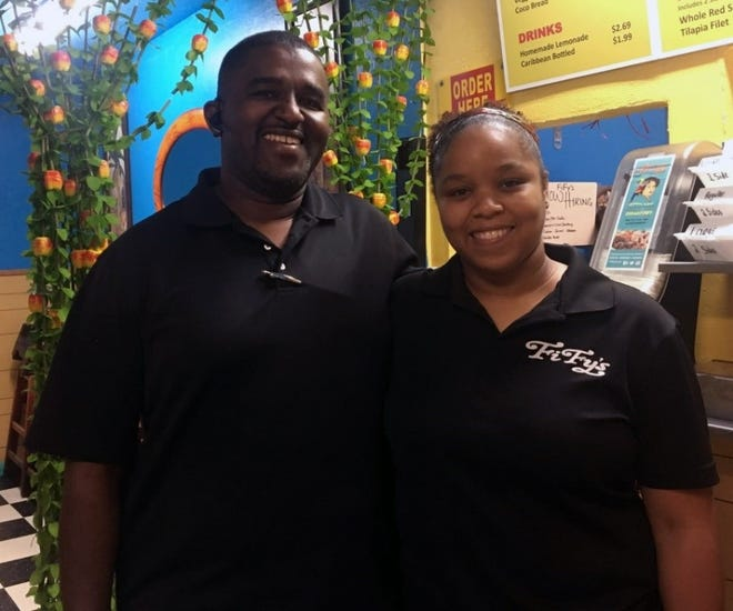 Franck Legrand Jr. visits his younger sister, Francesca Sainvilus, at Fify's Caribbean Cuisine on Feb. 15 in Immokalee, Florida. Fify's is named after Sainvilus' mother.