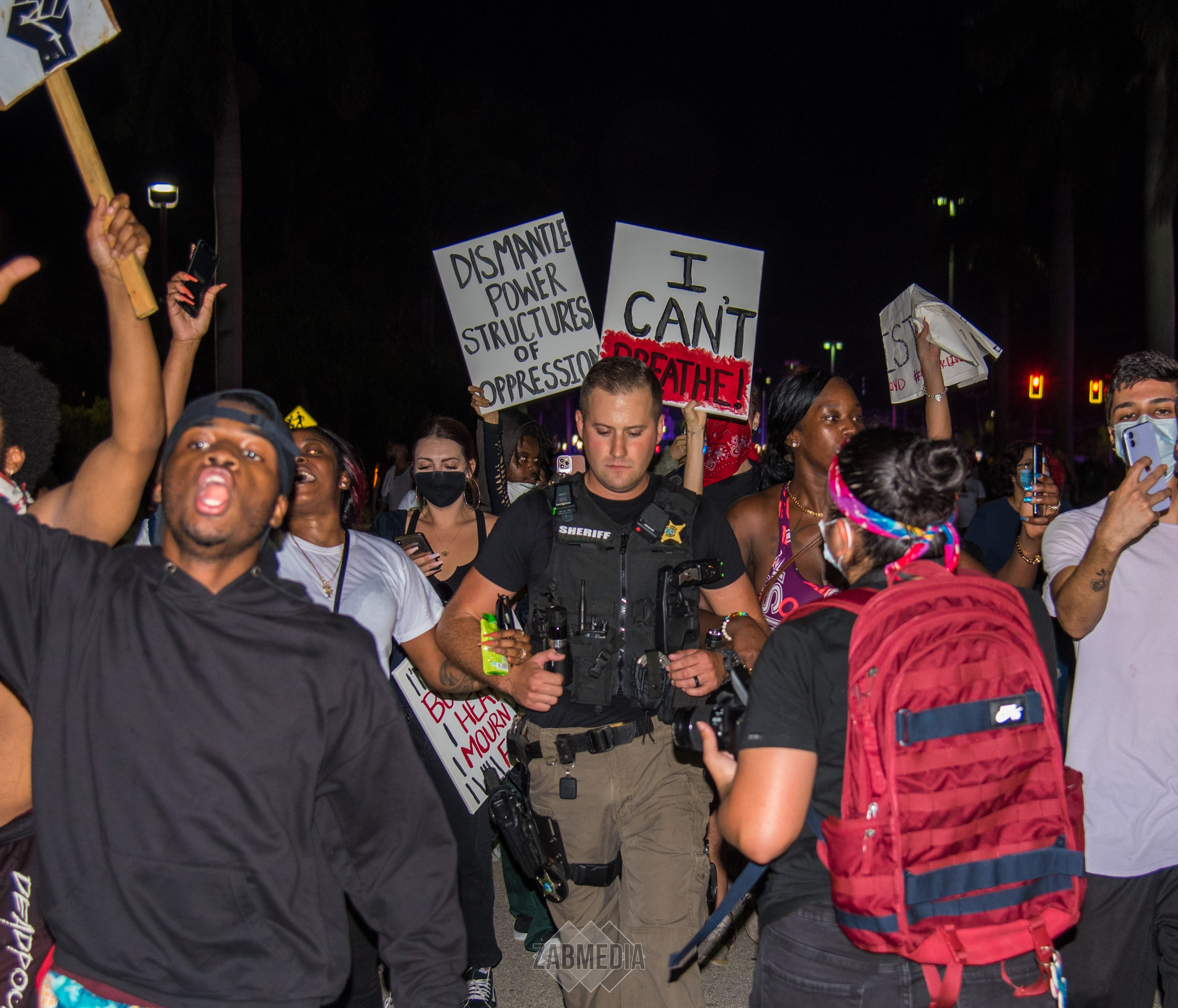 Lisa Martinez and Cherry Estelomme stepped forward to escort Collier County sheriff's corporal Dan McCoy when he expressed concern about walking amid a June 1 peaceful, but heated protest in Naples after the killing of George Floyd.