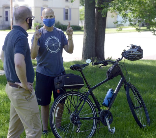Green Bay Mayor Eric Genrich, left, and Ald. Bill Galvin, talk before an announcement Wednesday about adding bike lanes to East Walnut Street.