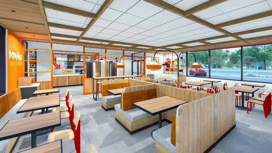 A view of the interior of Popeyes' new NOLA prototype restaurant design.