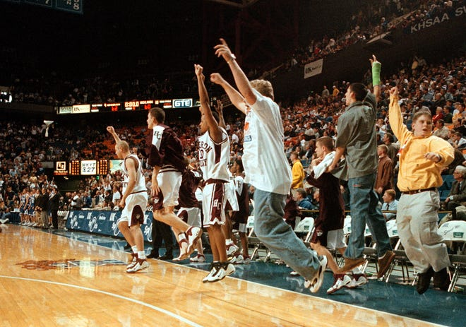 The Henderson County Colonel bench leaps to their feet as the buzzer sounds defeating the Highlands Bluebirds 62-60 in first round action at the 1999 Boys Sweet 16 Tournament in Lexington.