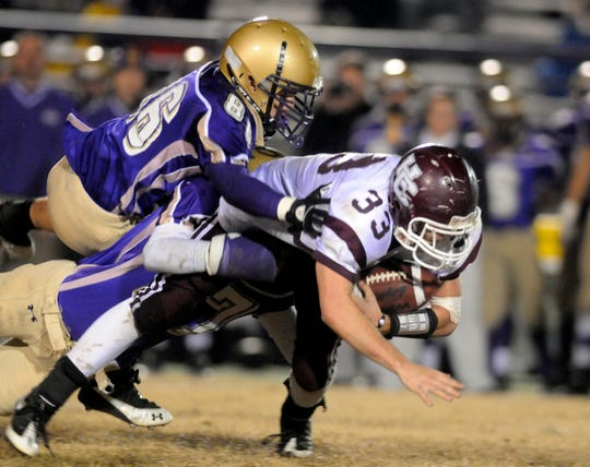 Henderson County's Conner Berry scrambles for yards in the 2010 6-A regional championship game at Male.