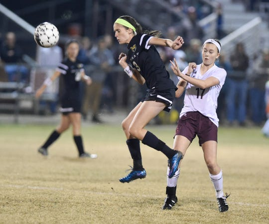 Murray's Lydia Grogan (left) heads the ball as Henderson's Hannah Jones challenges during the 2015 state tournament game in Henderson.
