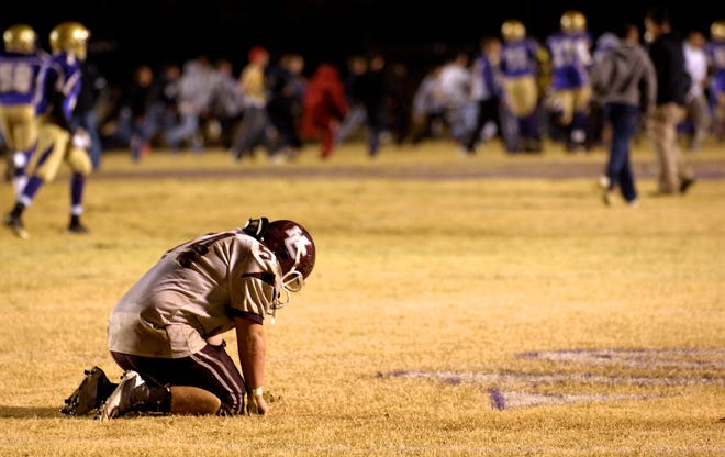 Henderson County senior Cody Holland reacts after a fumble in overtime ends the game with a 14-7 loss to Male in the 2010 6-A regional championship game in Louisville.