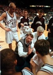 Henderson County Colonel coach Phil Gibson gives instructions to his team in a timeout in the closing seconds of their 1999 first round win over Highlands at the Boys Sweet 16 Tournament in Lexington.