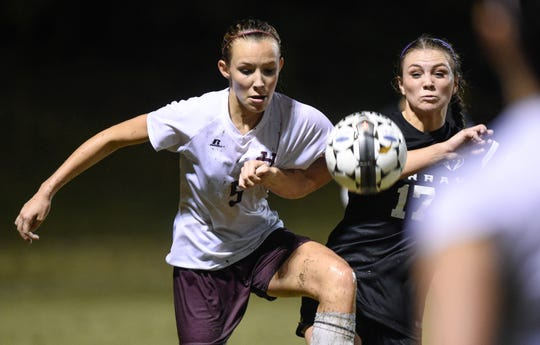 Henderson's Maddie Griggs (left) and Murray's Abigail Therell battle for the throw-in during the 2015 state tournament game in Henderson.
