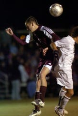 Henderson County's Cole Childress battles for control of the ball as the Colonels play the Greenwood Gators in the sub-section round of the 2008 state tournament in Bowling Green.