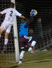 Henderson County goalie Ryan Crooke, right, defends against Greenwoods' Alex Belt in the 2008 state sub-sectional game in Bowling Green.