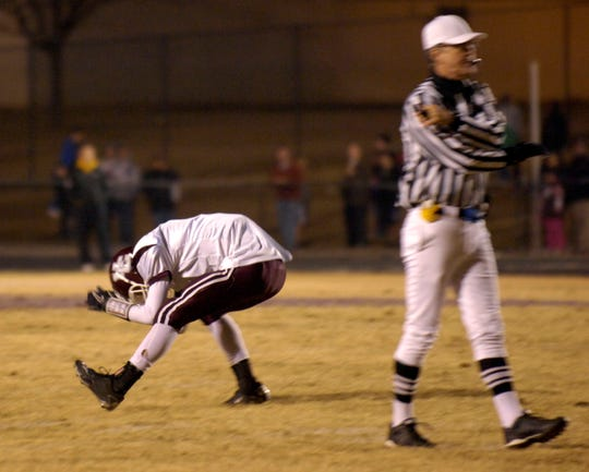 Henderson County's Brandon Potts reacts to missing a late fourth quarter field goal as the Colonels play Male, in the 2010 6-A regional championship game in Louisville.