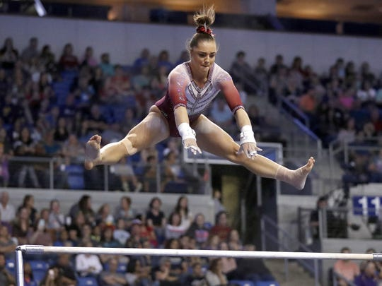 """Maggie Nichols, seen competing for the University of Oklahoma in 2017, said she was sexually abused by Larry Nassar in 2015. Described in documents as """"Athlete A,"""" Nichols inspired the title of a new Netflix documentary."""