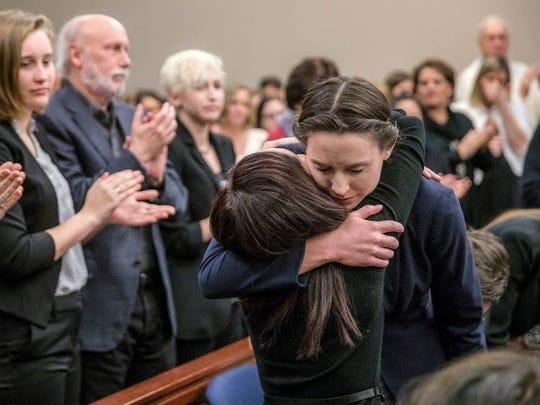 Rachael Denhollander, right, embraces Kaylee Lorincz, another survivor of sexual abuse by former USA Gymnastics doctor Larry Nassar, after Denhollander delivered her impact statement Jan. 24, 2018, in Lansing, Michigan.