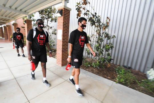 UL football players returned to campus for voluntary workouts wearing masks because of the coronavirus (COVID-19) pandemic.