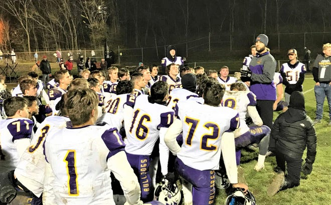 Bloom-Carroll coach Wade Bartholomew talks with his team after their 48-39 first-round playoff win against Indian Valley South last season. Bartholomew credits the consistency of having the same coaches at the junior high level as one of the biggest keys to the Bulldogs' success.