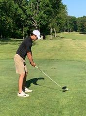 Brighton senior Nik Kowalenko prepares to tee off in a golf tournament for high school teams in Battle Creek on Saturday, June 6, 2020.