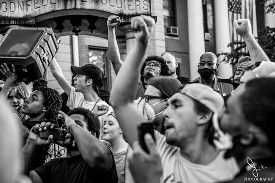 Protesters in Murray, Kentucky, demonstrate against police violence, with many calling for the removal of a Confederate monument.
